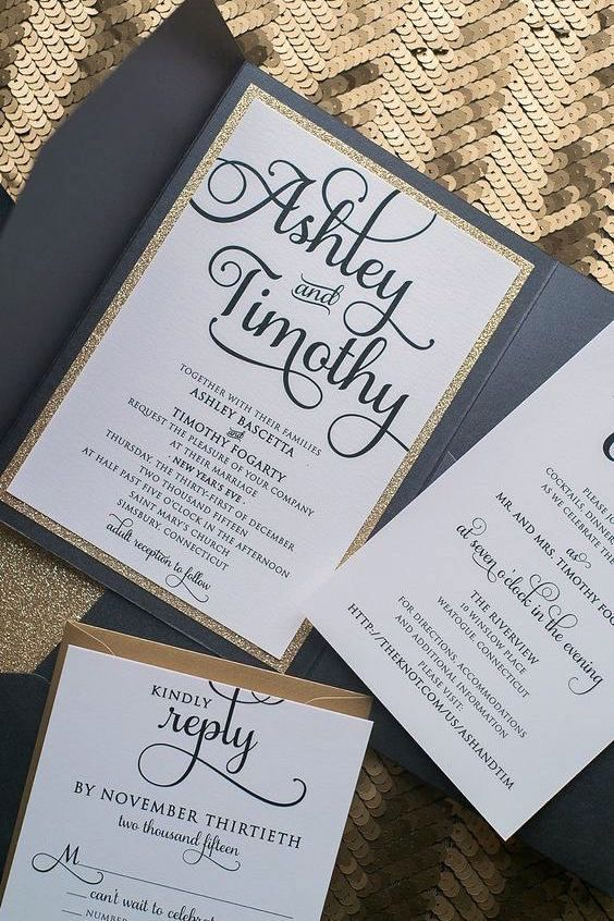 It's all about the fonts in this black and gold pocket wedding invitation by Just Invite Me.