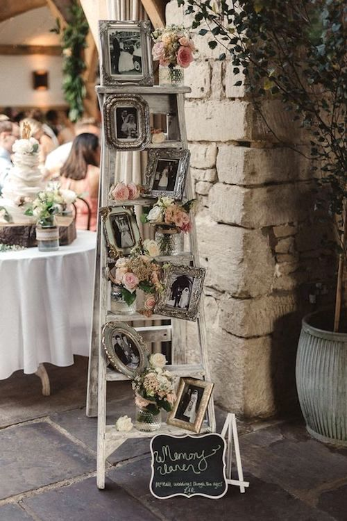 Remember loved ones at your wedding with an in loving memory vintage ladder filled with family photographs.