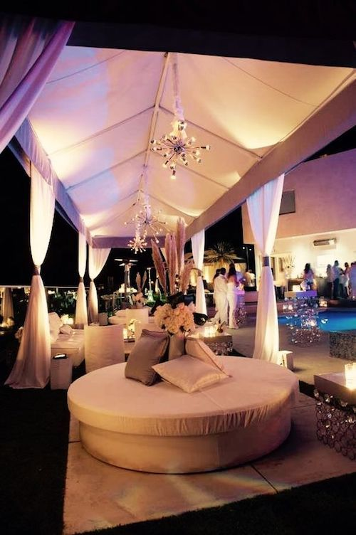 A long wedding tent decor could be the perfect match for decorating alongside your backyard pool. A few round sofas in the lounge area could not hurt either!