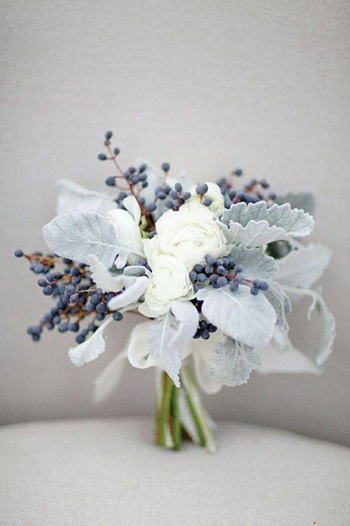 Clutch or loose-tied arrangement with white roses. Ideal for a petite bride.