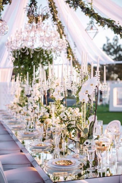 Glamorous marquee decor with sheer fabrics and partial openings so your guests can enjoy the surrounding garden.