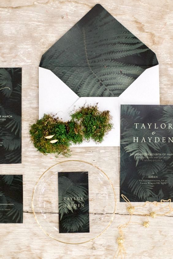 Moody colors and ferns on this stunning wedding invitation set by lisadigiglio.