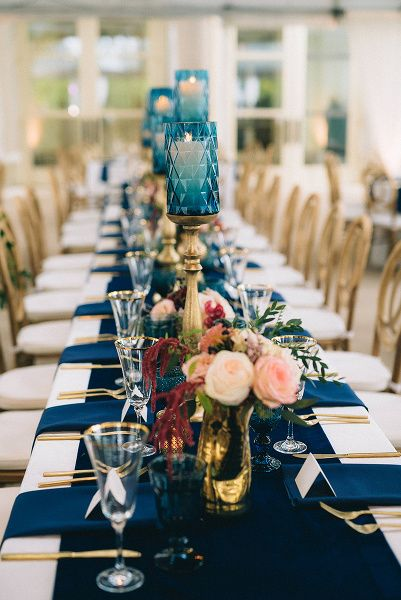 Stunning luxury wedding with velvet navy table runner, gold flatware, blush and burgundy florals by Sage Nines.