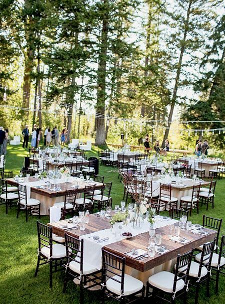 Fam friendly outdoor wedding at the Montana's Rivers Edge Ranch with square tables.