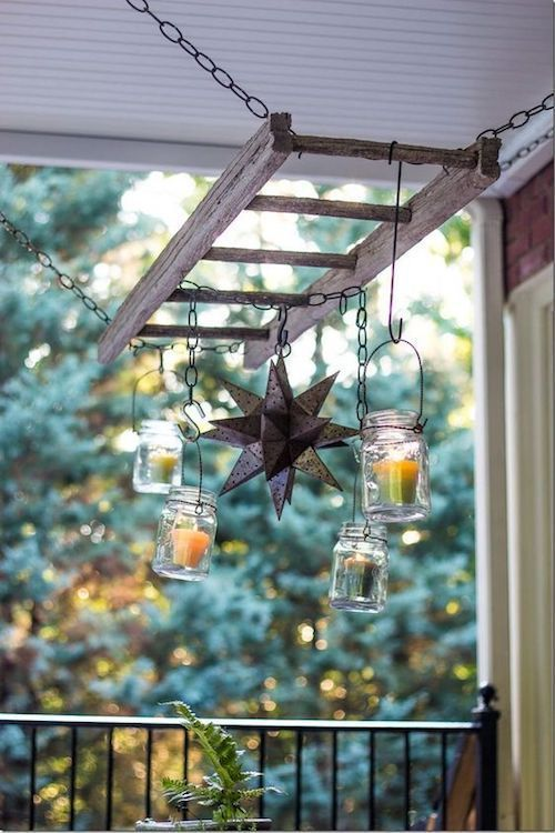 Hang mason jars and other decor from a ladder over a patio table.