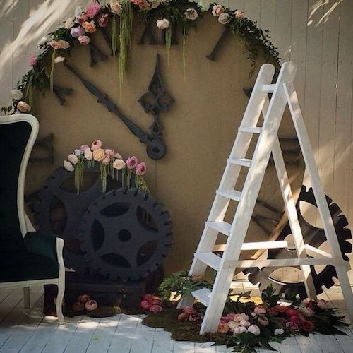 Stunning photo booth backdrop with a white vintage ladder and a fairytale feel. Who said Alice in Wonderland?