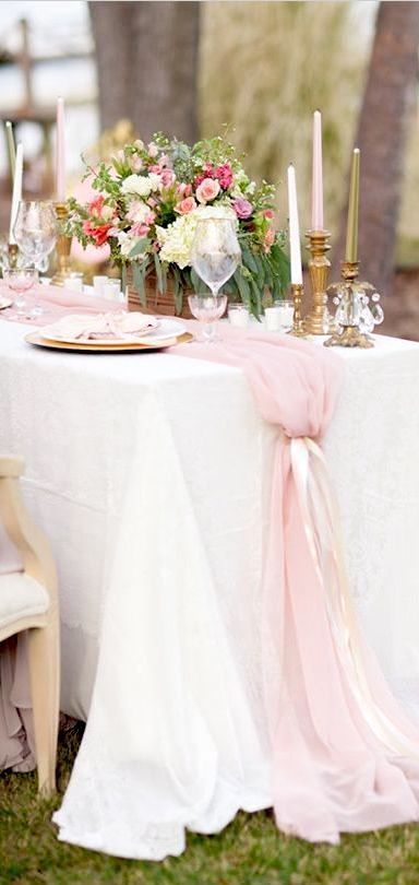 Pink chiffon table runners may also be tied with a ribbon for a more unique aesthetic.