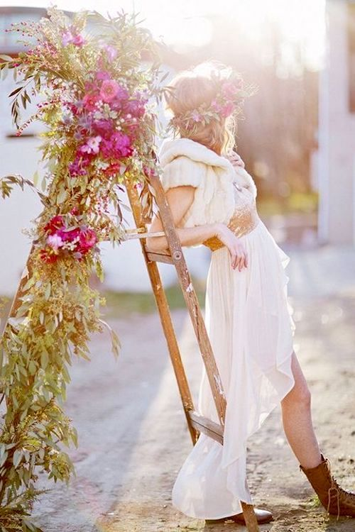 An old stepladder covered in flowers and eucalyptus leaves can be a gorgeous and unique backdrop for a wedding photoshoot session.
