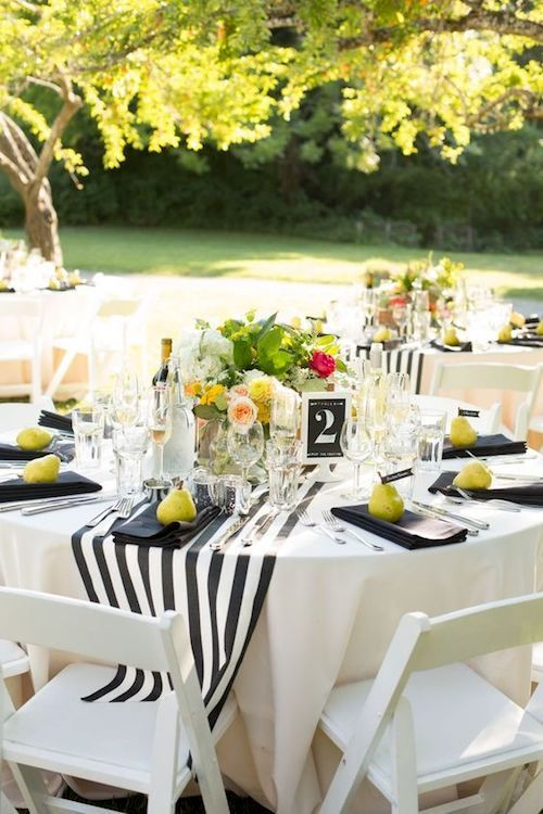 Short black and white striped table runner ideas for informal wedding receptions.