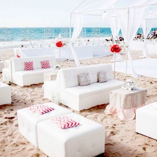Pure white sofas, coffee tables and tented areas on the beach with pops of color.