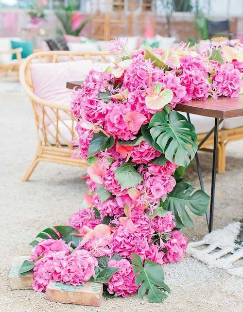This tropical floral runner is guaranteed impress your guests. Destination table runner ideas.