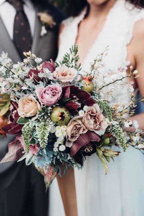Moody colors on a super pretty tussy mussy wedding bouquet.
