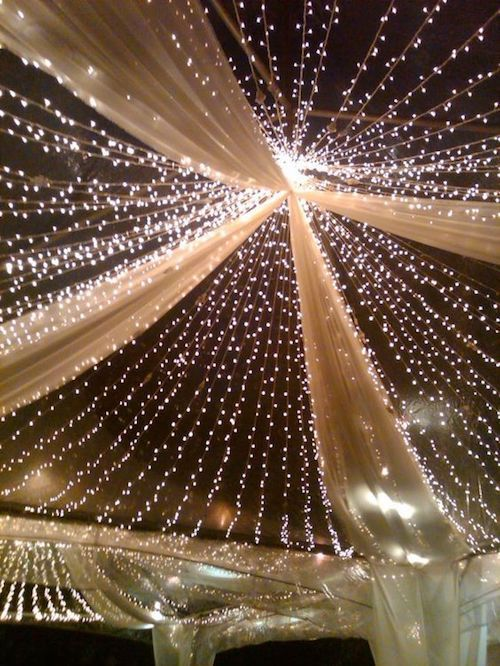 Twinkle lights and gold streamers wedding tent decor. TD!
