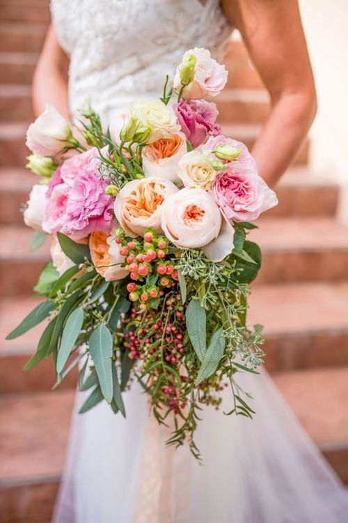 Pink, coral, orange and cream matching the springlike and cheery wedding color palette.