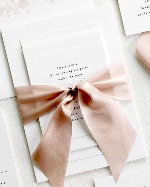 Timeless Alyssa wedding invitations by Airy calligraphy. Shown in black ink with a vintage blush garden rose liner and tied with Antoinette silk ribbon.