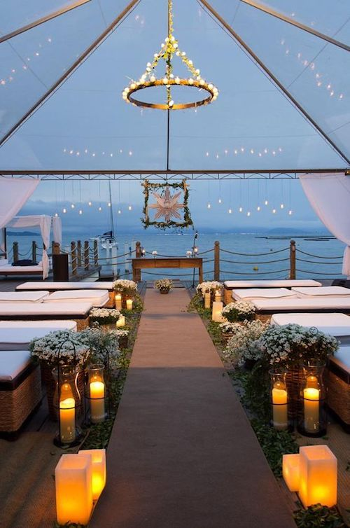 Breathtaking wedding tent decor for a beach wedding by Saint Morit's.