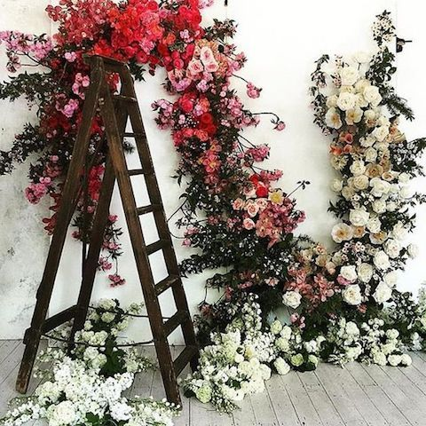Wedding wreaths and a gorgeous vintage wooden ladder to decorate your reception space.