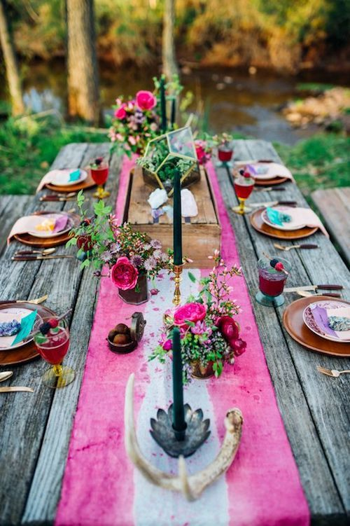 Colorful boho woodland wedding table runner ideas. The look includes antlers, moody colored candles and jewel tones for a Maryland wedding. Photo: Paula Bartosiewicz Photography.