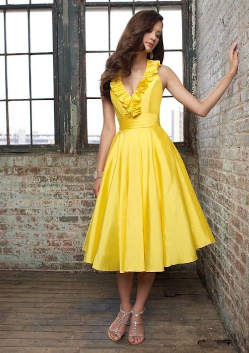 Shades of yellow paired with a pinch of gray is a palette that has long been high on our list of classics. Who wouldn't want to be your bridesmaid with this dress?