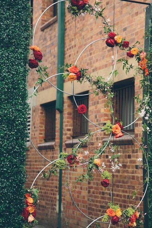 Follow these how-tos to DIY these giant wedding wreaths to decorate modern urban inner city venues.