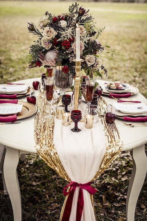 Blush, pink, gold, ivory and burgundy for a soft and feminine wintery feel. Let the wine and votives take care of the rest.