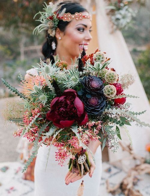This boho folk bridal bouquet incorporates the rusticity of the desert and the rich hues of a dark and moody vibe.