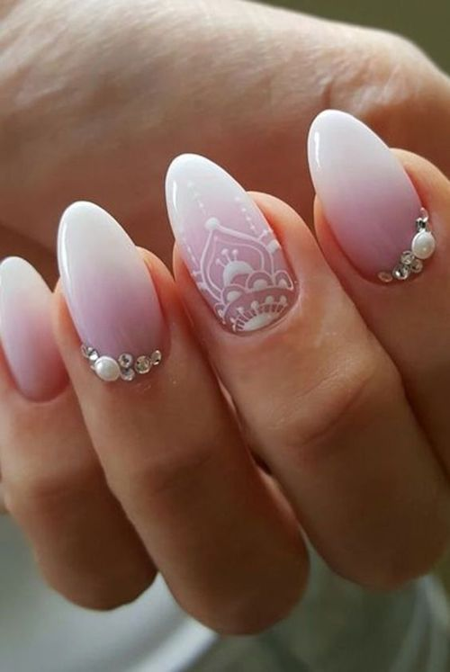 Bridal almond nails that are TD.