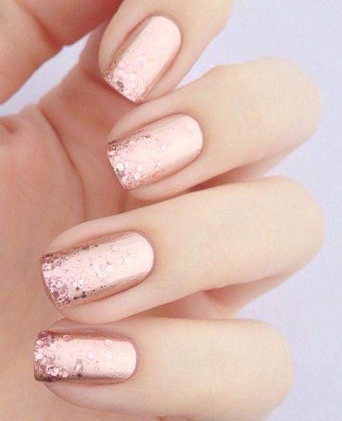 Metallics and glitter in rose gold, a new bridal nail art classic.