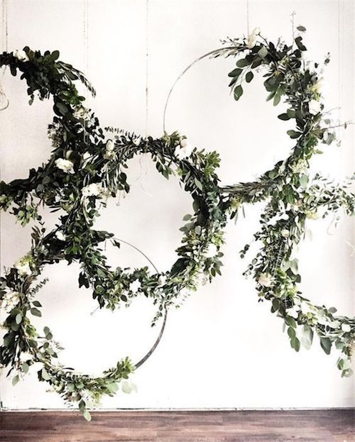 Creating a unique and dramatic ceremony backdrop has never been easier. Check out how to DIY giant wedding wreaths with hula hoops.