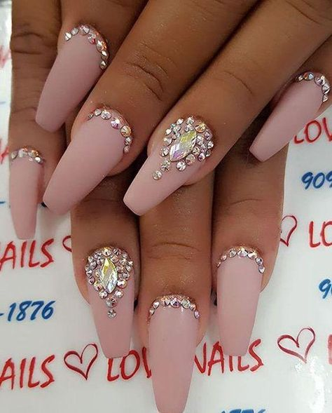 Try a set of coffin nails in blushing pink. Then add your choice of 3D jewel accents.