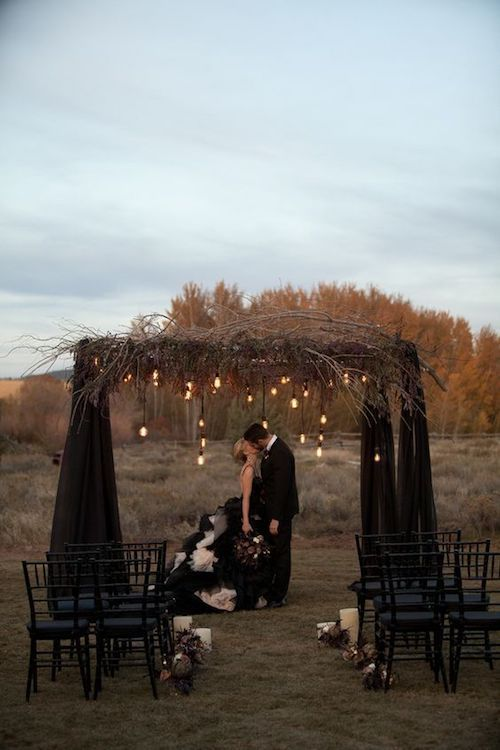 Fall is a great season for the dark and moody aesthetic. Add some deep browns and twigs to your ceremony lights.