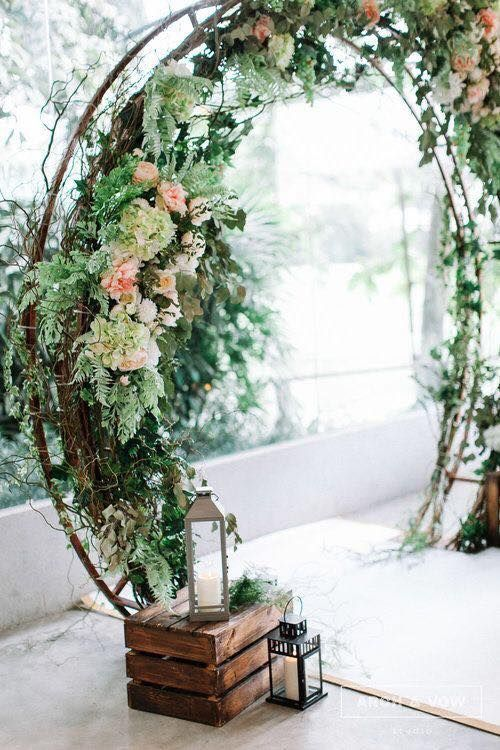 We are absolutely wowed by the wood and floral wedding wreath of this shoot. Customize yours to fit your wedding scene and season.