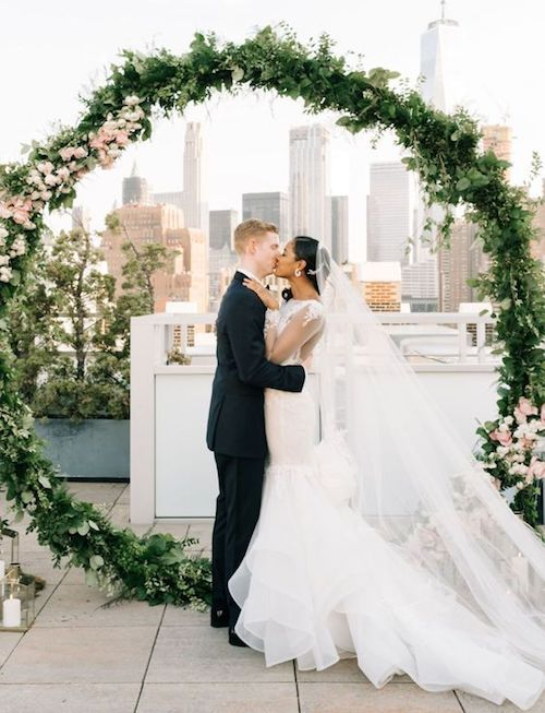 The urban aesthetic could not miss out on this trend. Turn your NYC rooftop into the most extra party of them all with the skyline views and a giant wedding wreath ceremony backdrop.