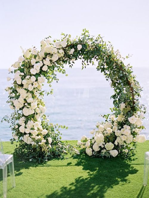 Giant wreath with lush florals for a seaside affair.