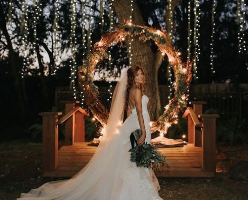 Drop the flowers and add string lights for a glowing giant wedding wreath backdrop.