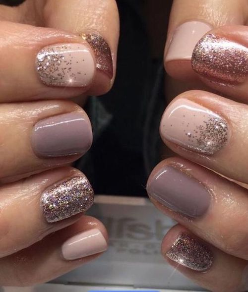 Swoon-worthy and delicate neutral colors with glitter nail designs.