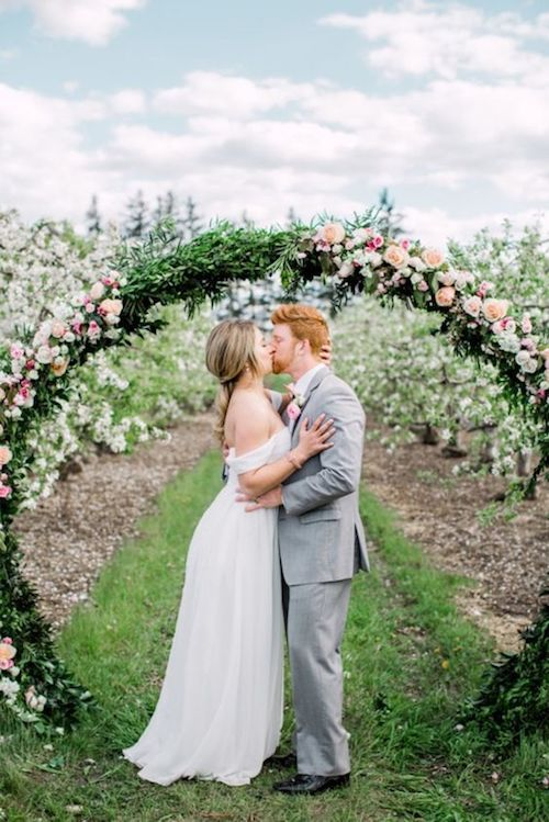 Breathtaking greenery and florals wedding arch.