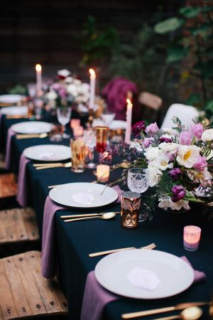 For a winter affair dress your tables in navy blue and liven them up with some pops of pink. The wooden chairs give it a more outdoorsy look. Switch them for clear ones for a modern aesthetic. Anna Wu Photography.