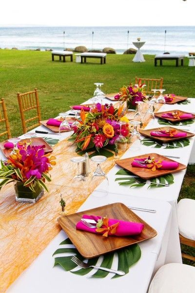 Local flowers are a must for Hawaii beach wedding table decor. By Sunya Flowers and Plants.