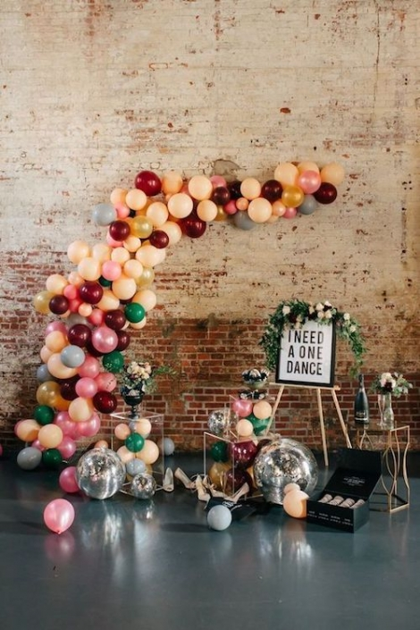 Colorful balloon vignette for the wedding favors area. Sophie Mathewson Photography.