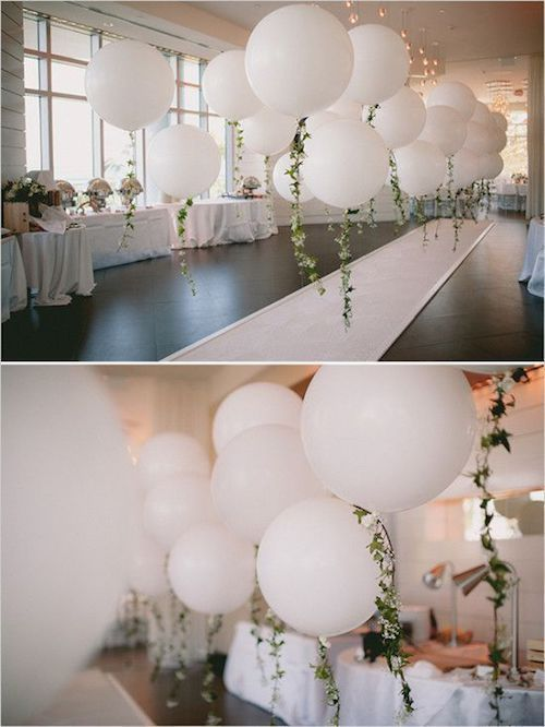 Garlands on the balloon tails for a vintage aesthetic.