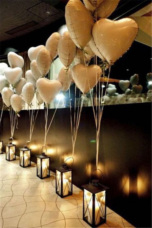 Balloons and lanterns line up the entryway to the wedding reception.