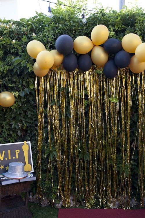 Golden fringes and balloons photobooth backdrop ideas.