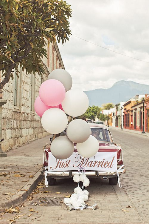Add a few balloons to the send off car. Photo courtesy: Orange Turtle Photography.