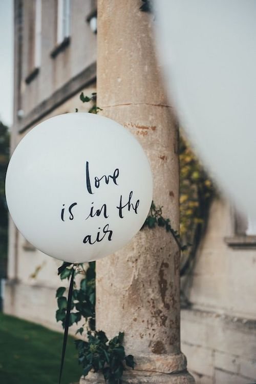 Giant Kate Spade balloons with sweet sayings add unexpected accents to your wedding venue.