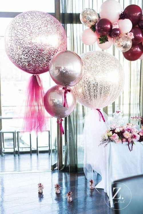 Mylar and giant silver balloons with tulle and glitter with a fancy vibe. Check out the DIY!