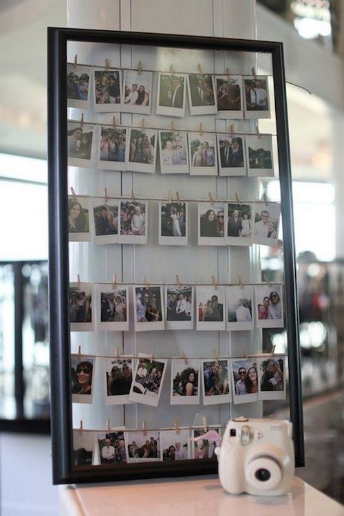 Make a banner of the Polaroids and hang them all on some board.