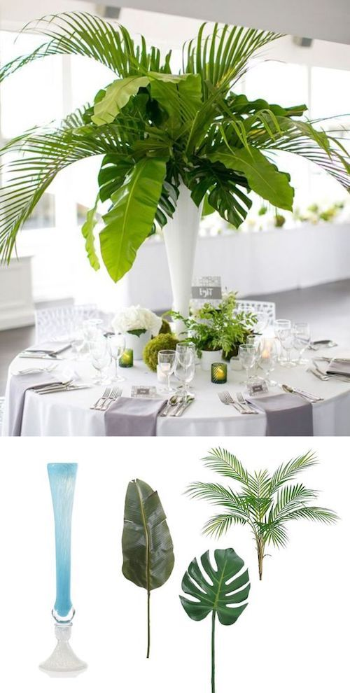 An elegant look for a beach wedding. Tall summer centerpieces with tropical palm leaves surrounded by green votives and small potted ferns.