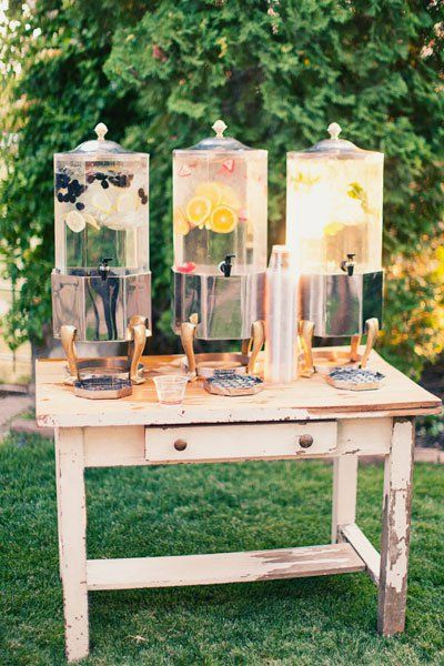 Refreshing beverages in stylish dispensers for an irresistible look perfect for a backyard wedding.
