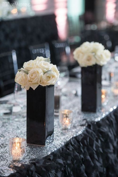 Luxurious black and white roses centerpieces.